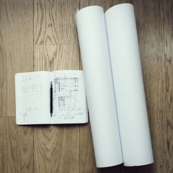 an image of an architects notebook and blueprints