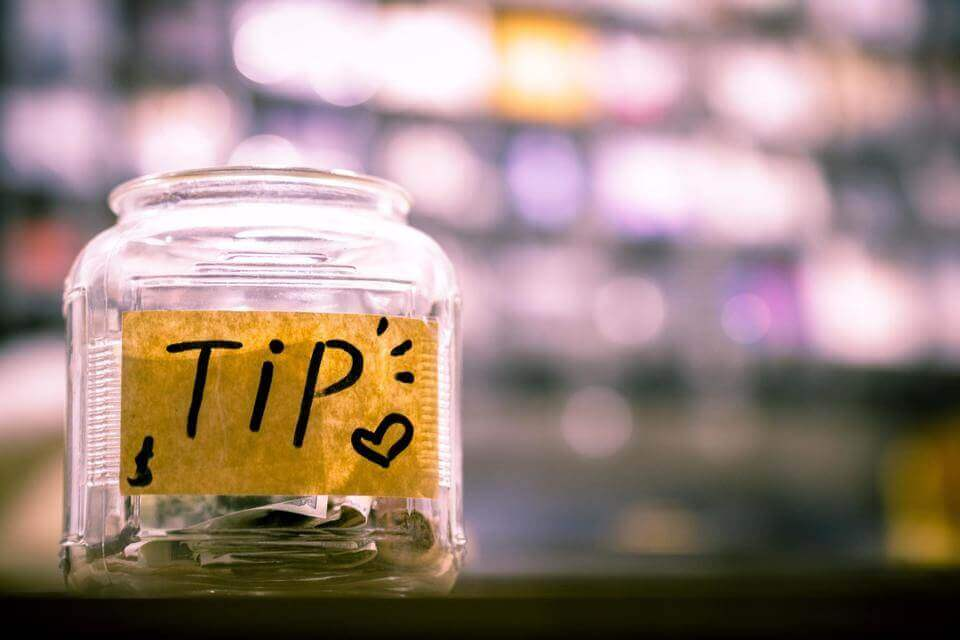 a photo of a jar of tips.