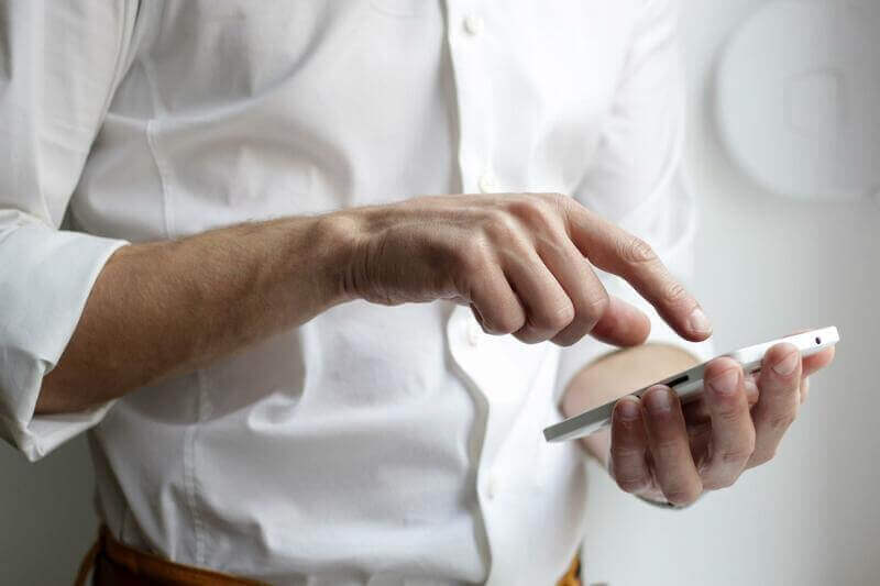 an image of a man using a phone.
